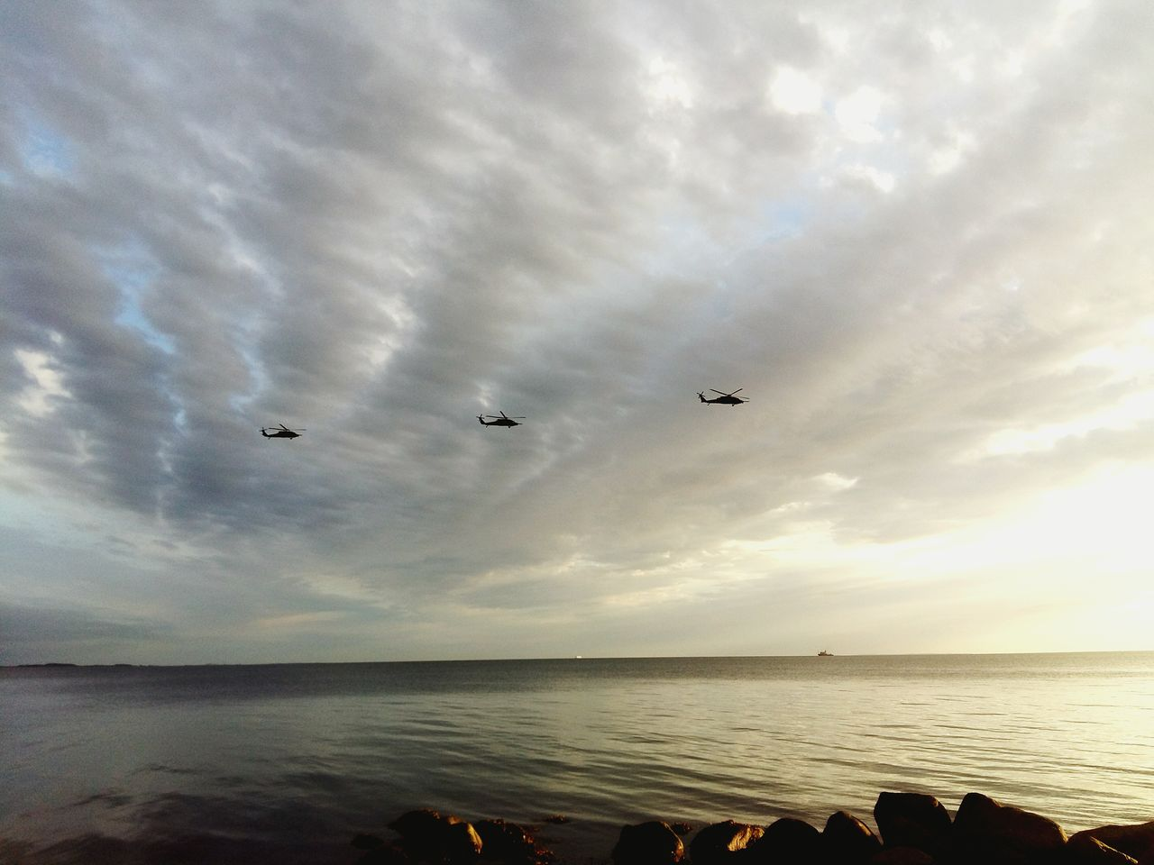 flying, sky, sea, water, cloud - sky, horizon over water, beach, silhouette, airplane, mid-air, nature, outdoors, scenics, no people, bird, beauty in nature, day, animal themes