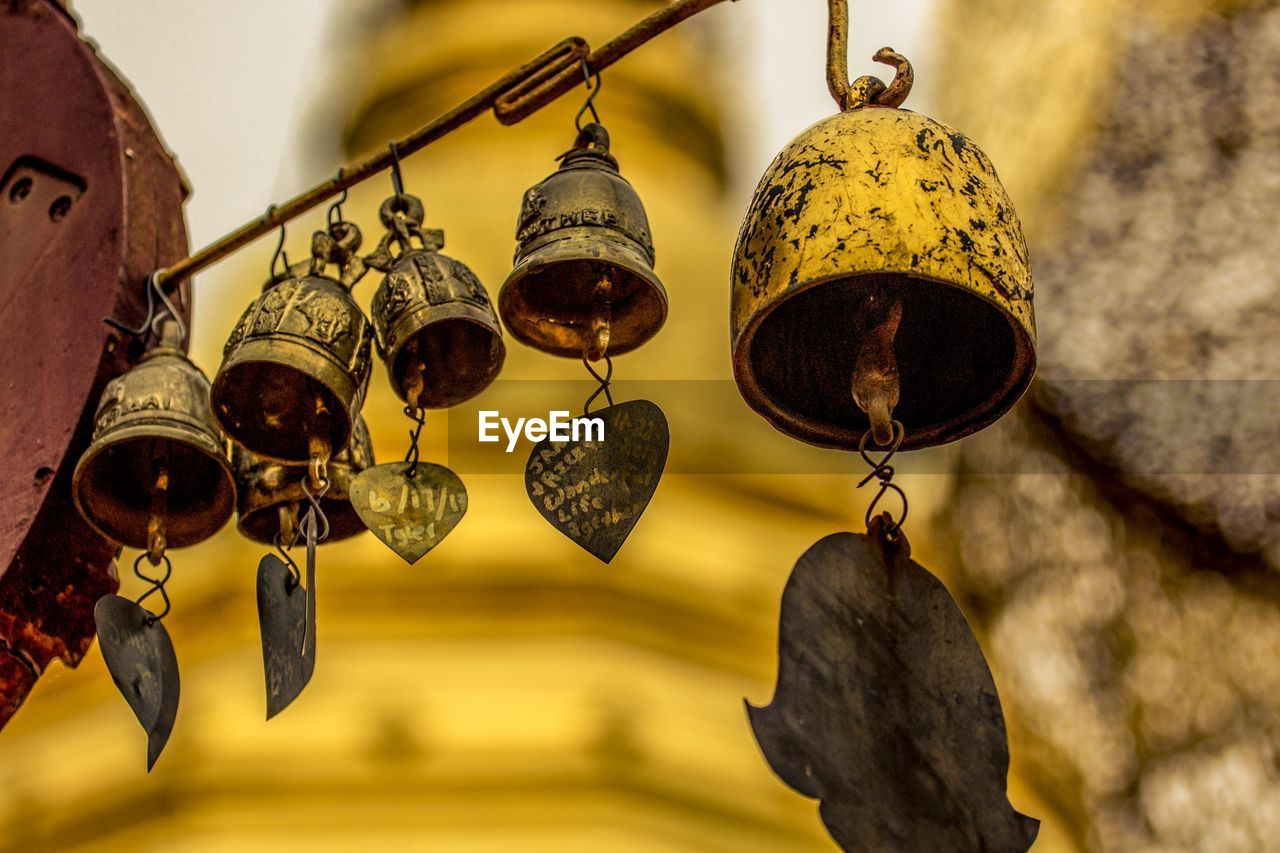 Low angle view of bells hanging outdoors