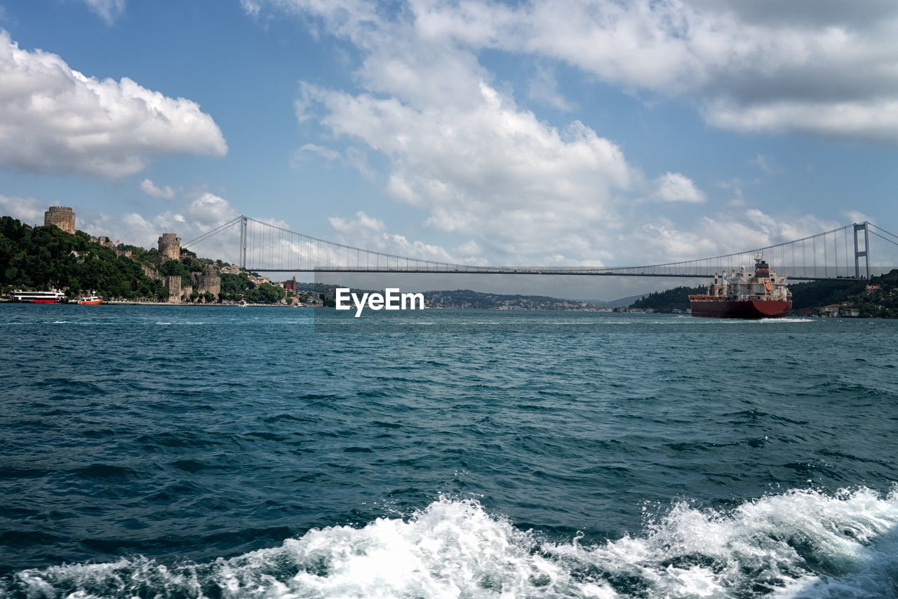 water, sky, cloud - sky, sea, transportation, nautical vessel, bridge, nature, bridge - man made structure, connection, architecture, travel, waterfront, built structure, day, scenics - nature, motion, mode of transportation, beauty in nature, no people, outdoors, bay