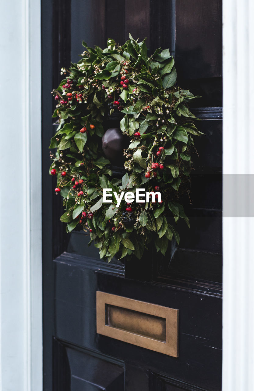 Close-up of wreath on black door