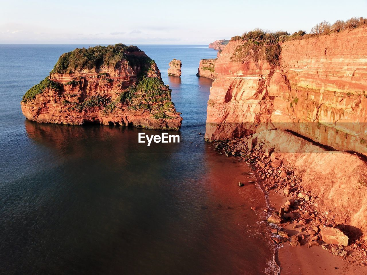 water, sea, rock, rock - object, solid, rock formation, scenics - nature, sky, tranquil scene, beauty in nature, tranquility, horizon over water, nature, cliff, no people, land, idyllic, horizon, day, stack rock, outdoors, eroded, formation