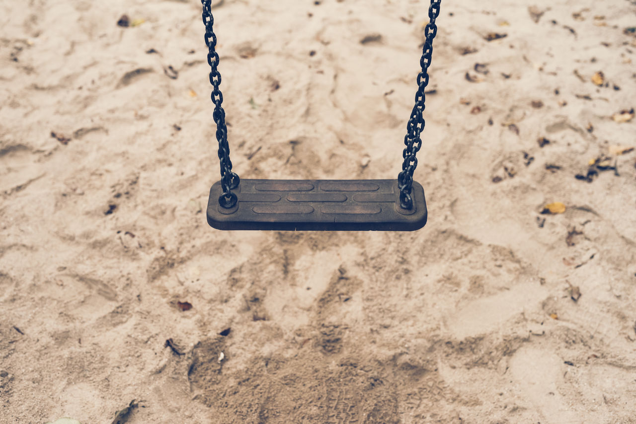 playground, swing, sand, childhood, chain, land, day, focus on foreground, outdoor play equipment, beach, hanging, nature, outdoors, absence, empty, metal, close-up, high angle view, sunlight