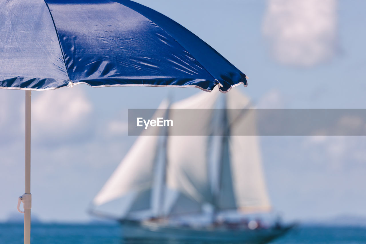 Blue Umbrella At Beach Against Sky During Sunny Day