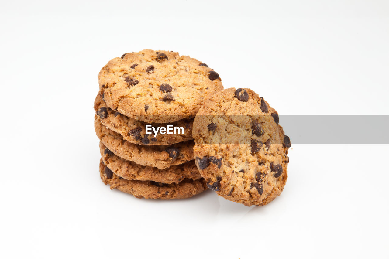 studio shot, cookie, white background, baked, sweet food, chocolate, food, food and drink, chocolate chip cookie, still life, indoors, chocolate chip, indulgence, cut out, no people, close-up, stack, temptation, unhealthy eating, snack, small group of objects