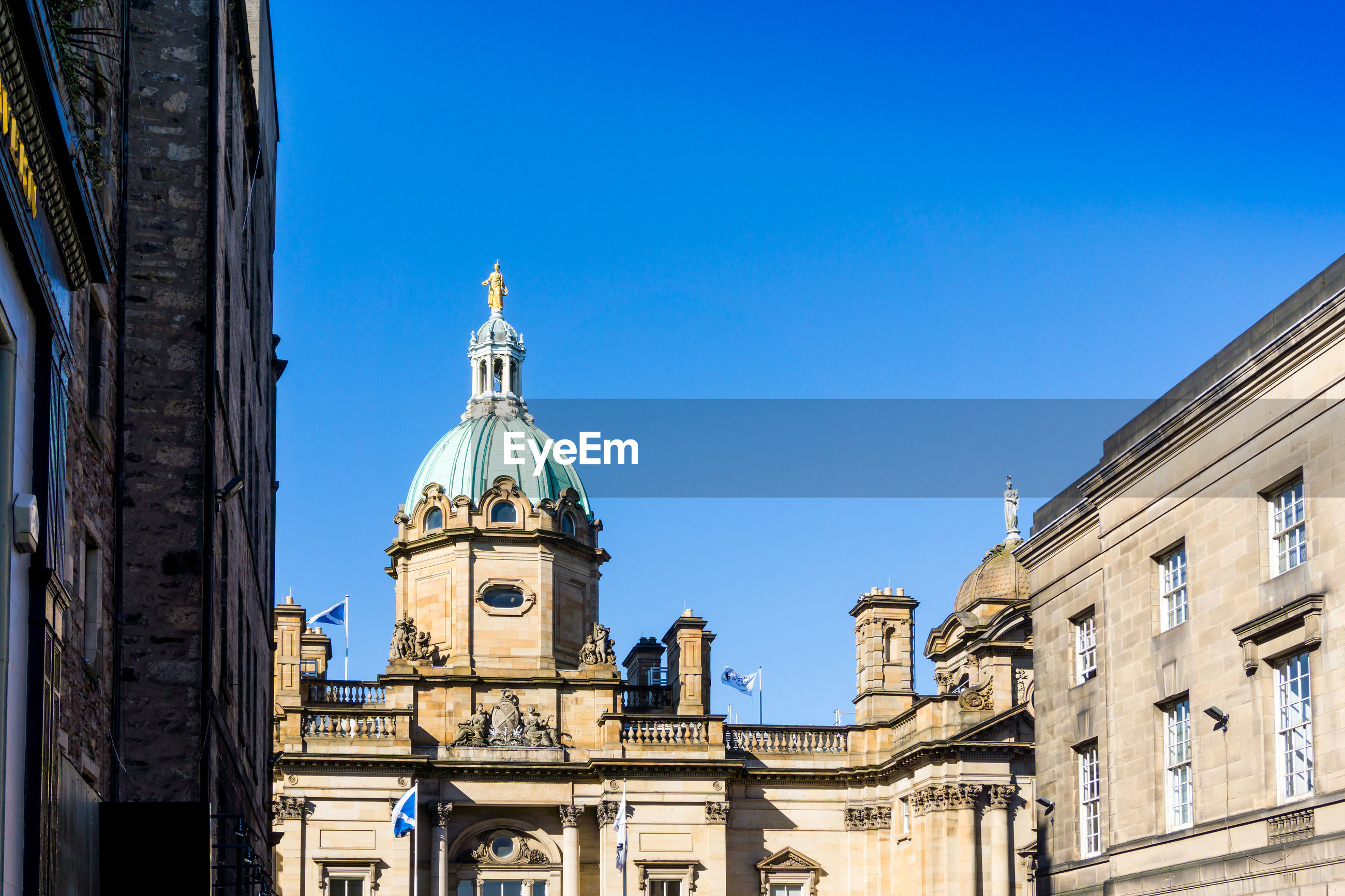 Bank of scotland against clear blue sky