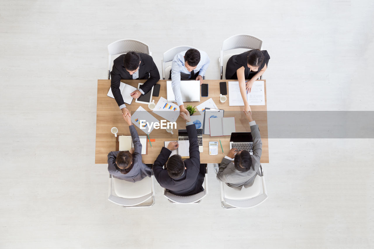 High angle view of business people discussing in meeting at office