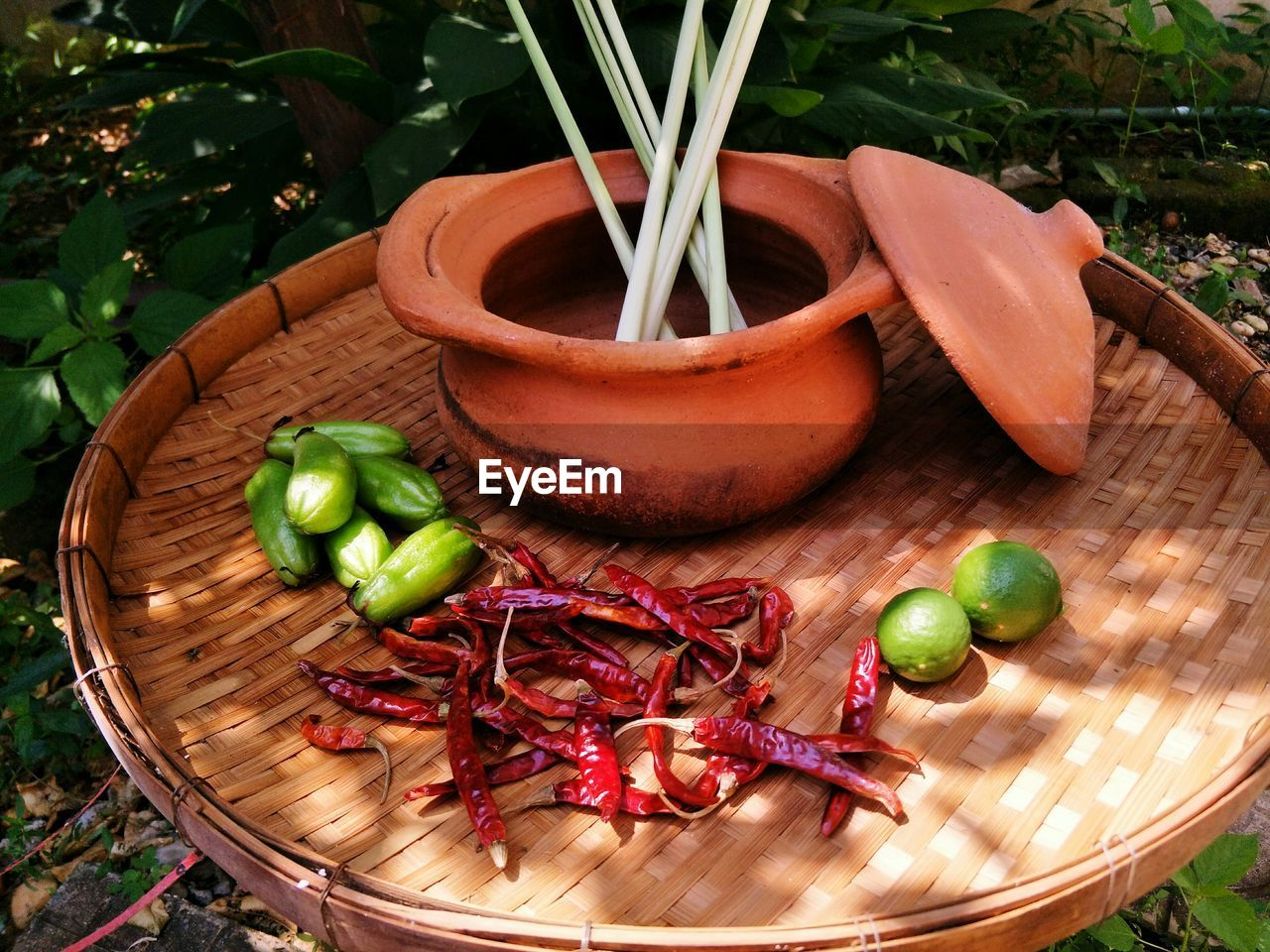 food and drink, food, vegetable, healthy eating, wellbeing, freshness, no people, high angle view, pepper, spice, chili pepper, fruit, wood - material, container, green color, table, still life, close-up, day, onion, red chili pepper, herb