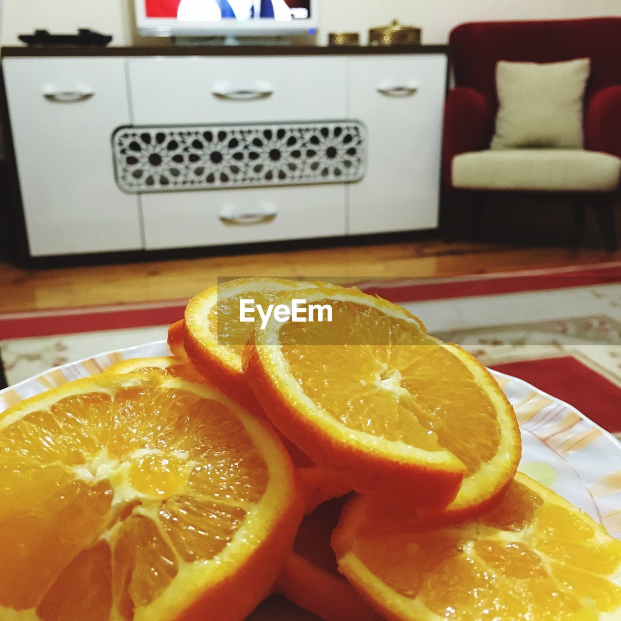 Close-up of orange slices in plate at home