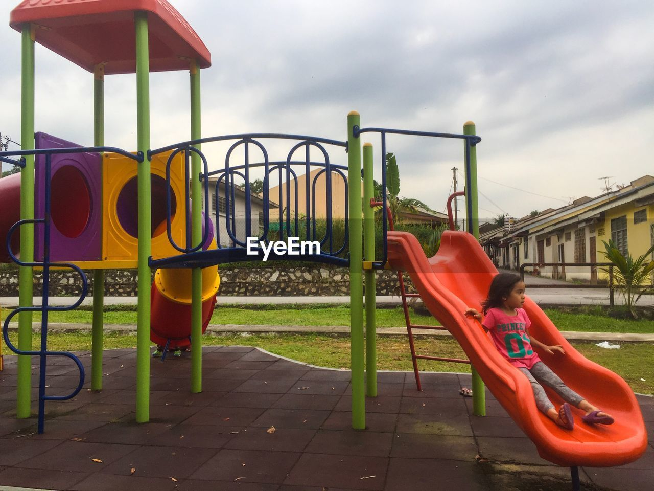 playground, childhood, slide, outdoor play equipment, sky, outdoors, full length, day, park - man made space, real people, built structure, one person, tree, grass, architecture, people