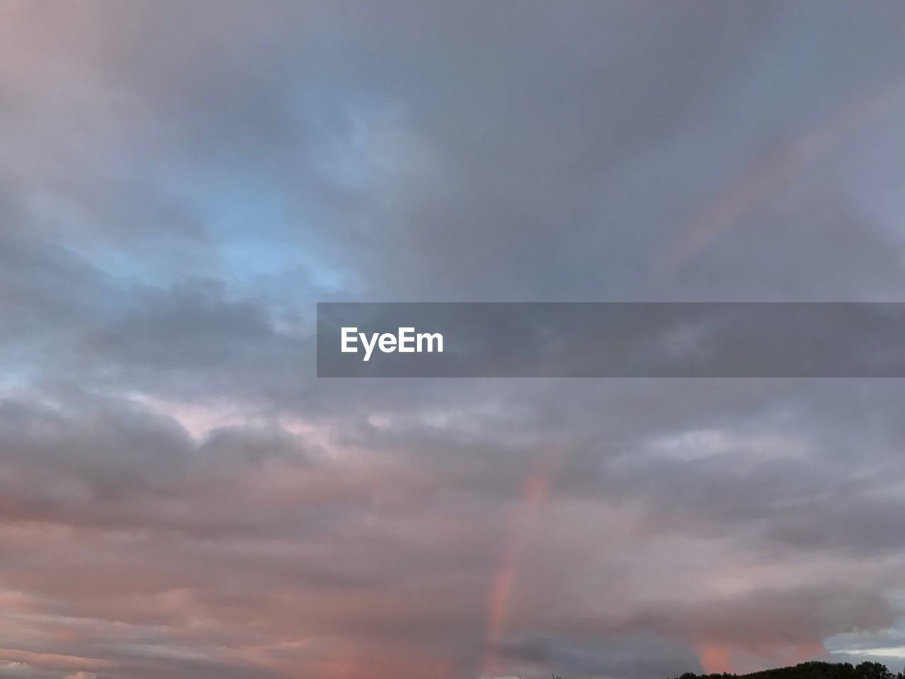cloud - sky, sky, rainbow, beauty in nature, scenics, weather, nature, no people, outdoors, low angle view, multi colored, sunset, day, storm cloud, vapor trail