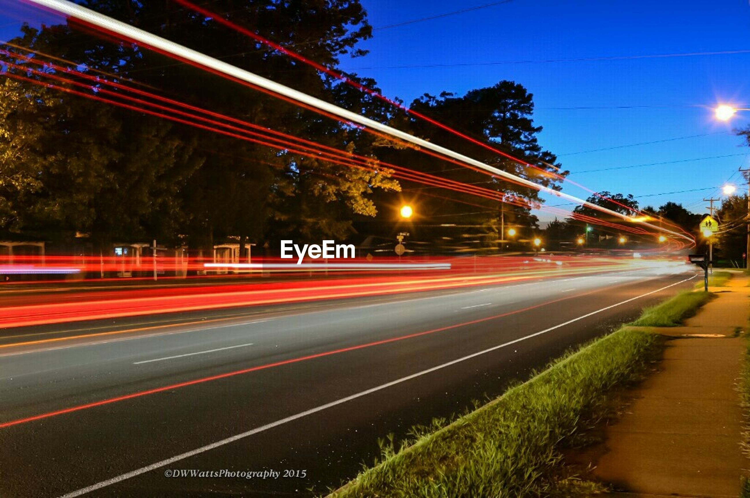 illuminated, light trail, long exposure, night, speed, motion, transportation, blurred motion, road, traffic, street, city, street light, sky, building exterior, on the move, city life, tail light, highway, architecture