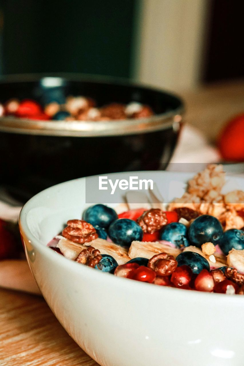 food, food and drink, bowl, indoors, close-up, freshness, focus on foreground, table, still life, ready-to-eat, no people, healthy eating, wellbeing, selective focus, fruit, meal, serving size, breakfast cereal, indulgence, breakfast, temptation, crockery, snack