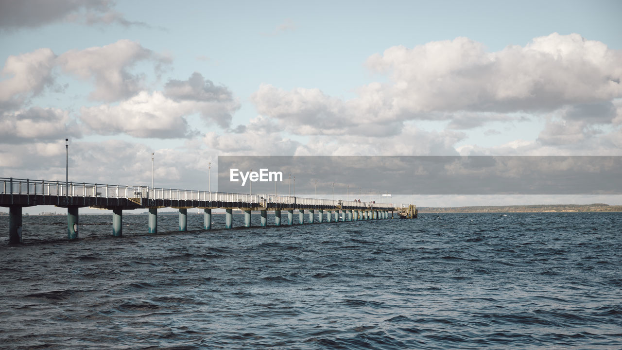 bridge - man made structure, cloud - sky, connection, sky, water, sea, nature, day, waterfront, outdoors, no people, architecture, scenics, built structure, beauty in nature