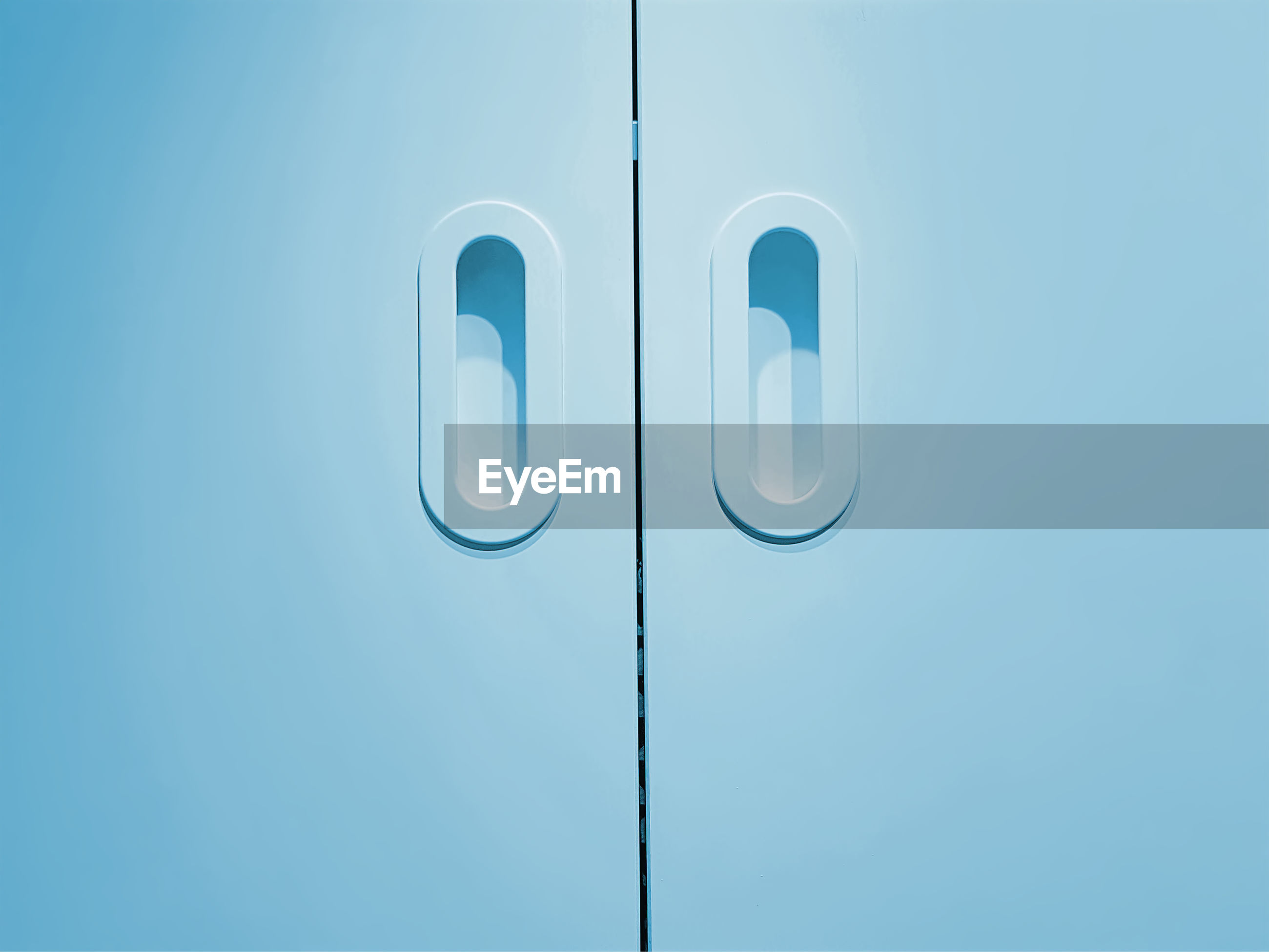 Full frame background of closed cyan wooden door