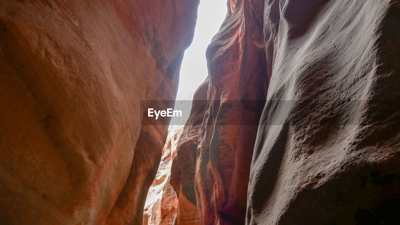 rock formation, rock, beauty in nature, scenics - nature, no people, rock - object, tranquility, nature, low angle view, non-urban scene, geology, physical geography, solid, sky, day, tranquil scene, travel destinations, environment, sunlight, outdoors, eroded, formation, arid climate, flowing water