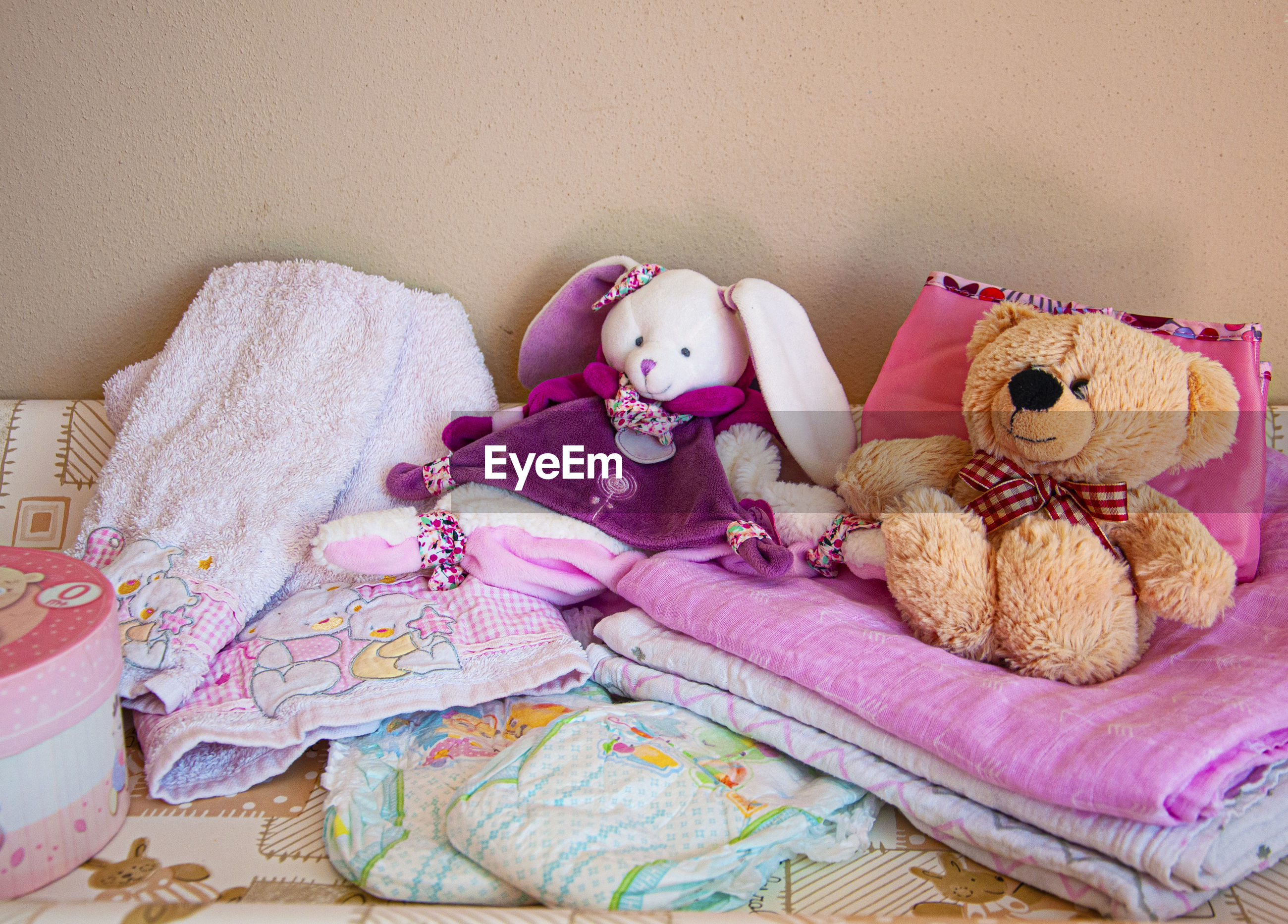 HIGH ANGLE VIEW OF TOYS ON BED AT HOME