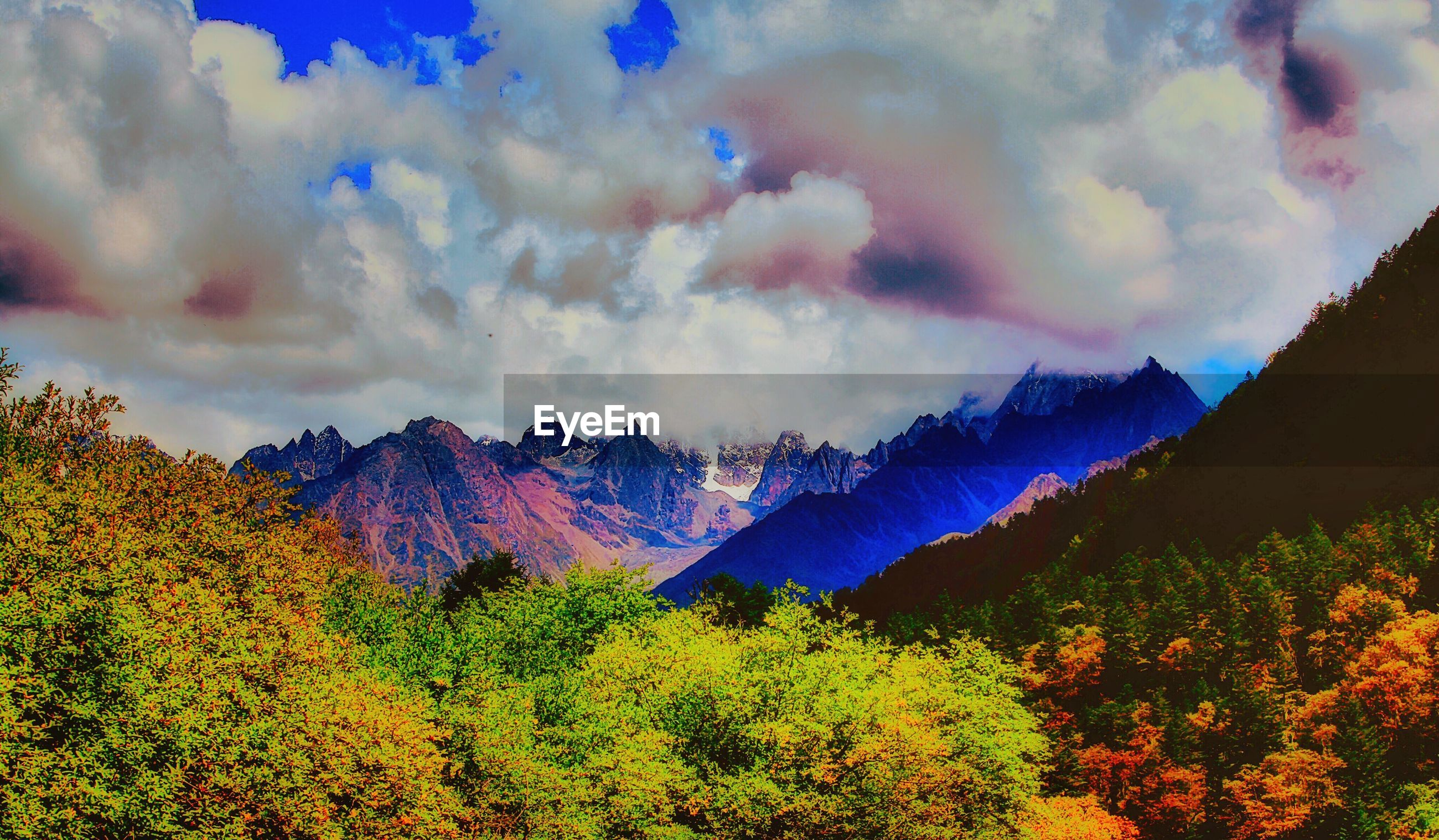 mountain, beauty in nature, scenics, tranquil scene, sky, tranquility, landscape, nature, cloud - sky, tree, growth, mountain range, idyllic, cloud, non-urban scene, cloudy, plant, no people, lush foliage, majestic