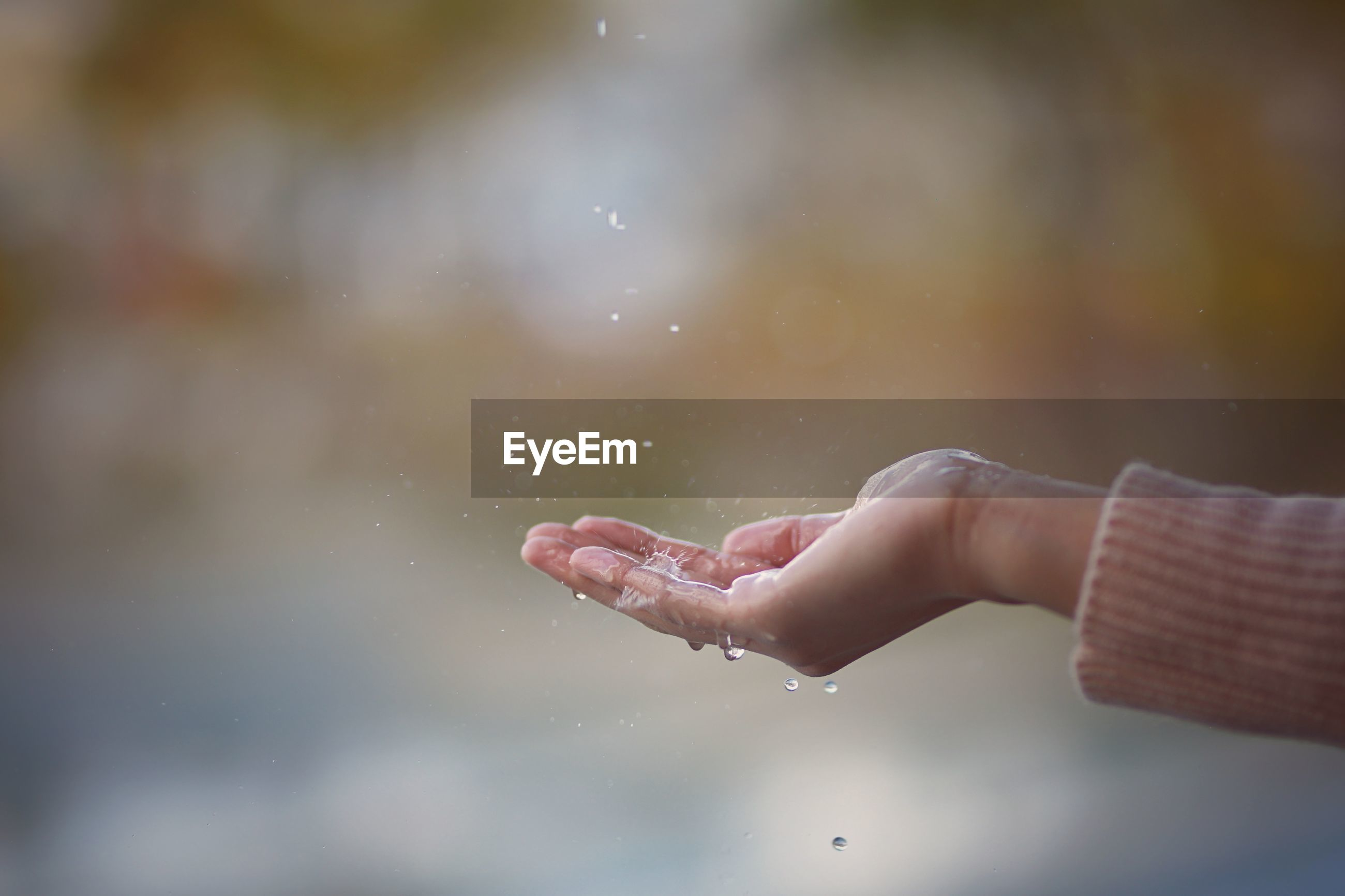Close-up of hand holding water