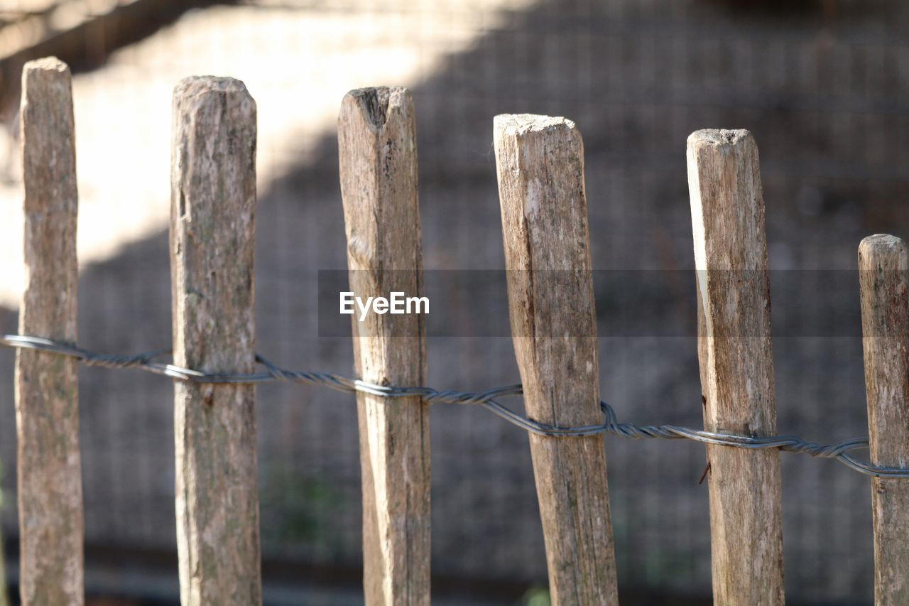 Wooden Fence Tied With Metal Wire