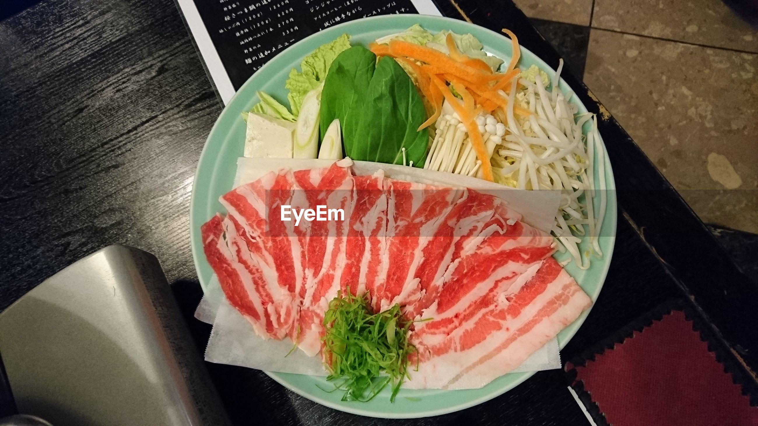 Directly above shot of shabu shabu in plate on table