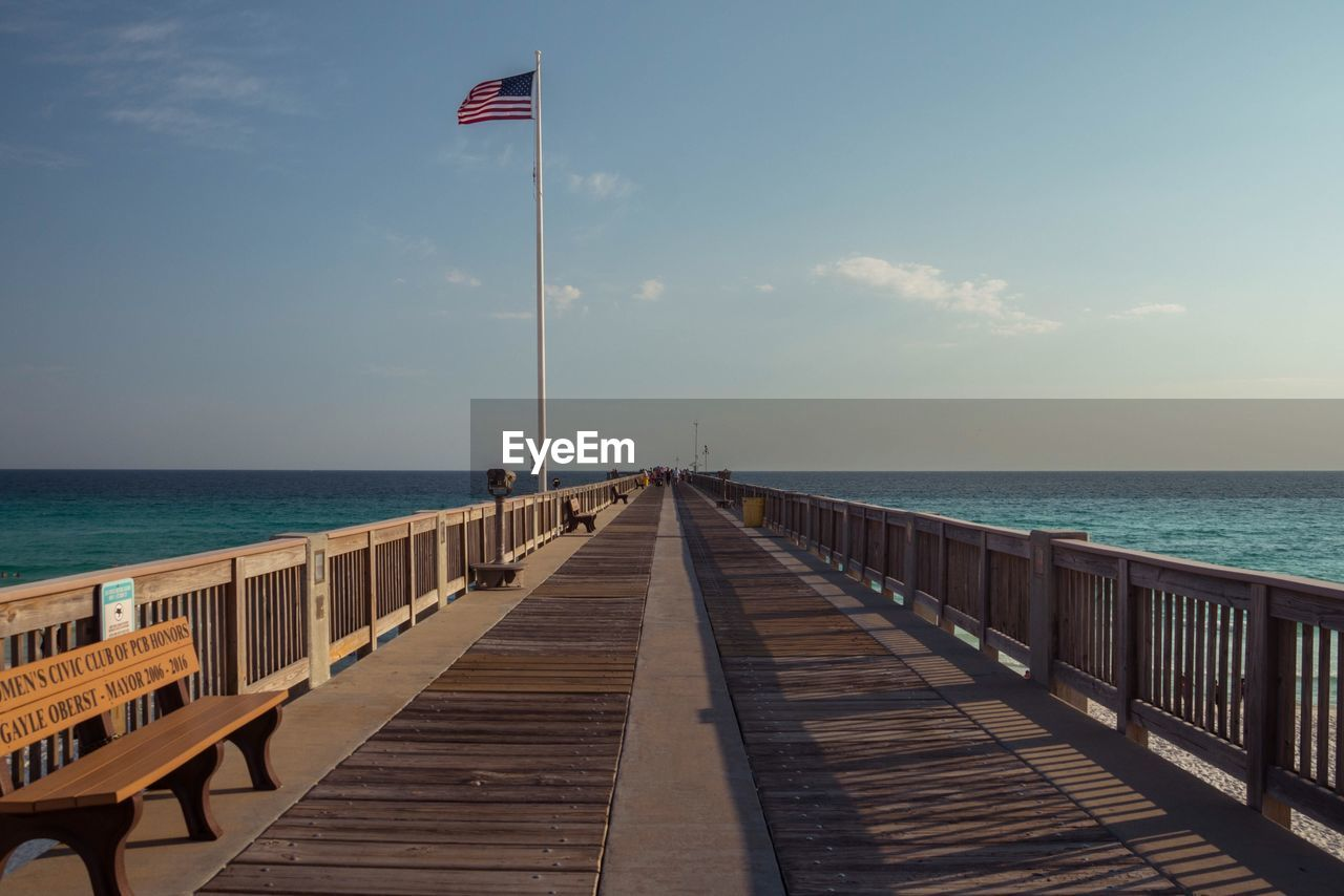 water, sea, sky, horizon over water, horizon, scenics - nature, direction, the way forward, nature, beauty in nature, pier, tranquility, tranquil scene, railing, wood - material, day, land, no people, sunlight, diminishing perspective, outdoors