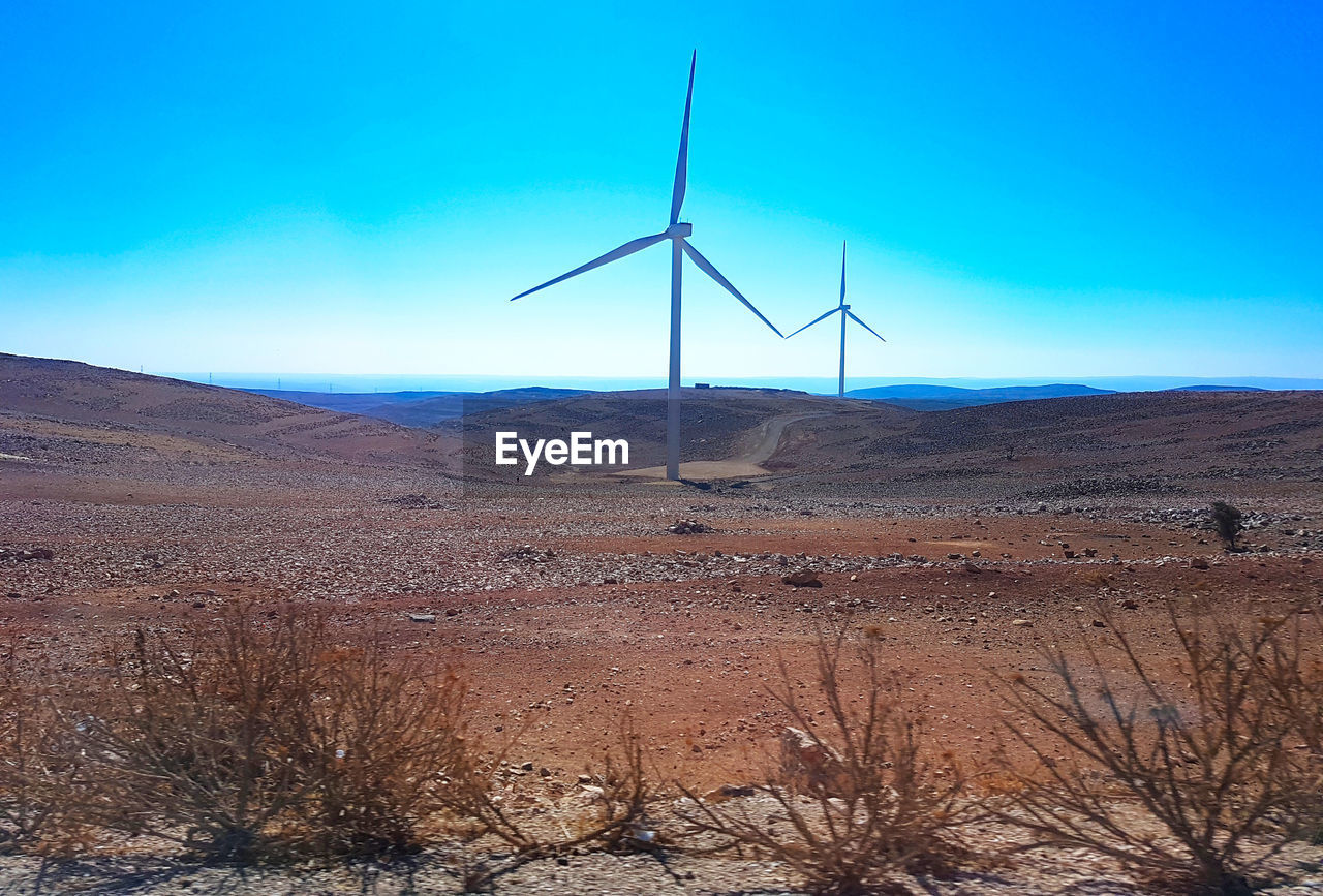 environment, environmental conservation, renewable energy, fuel and power generation, wind turbine, alternative energy, turbine, landscape, wind power, sky, land, scenics - nature, blue, non-urban scene, arid climate, tranquil scene, nature, desert, tranquility, beauty in nature, climate, no people, sustainable resources, outdoors