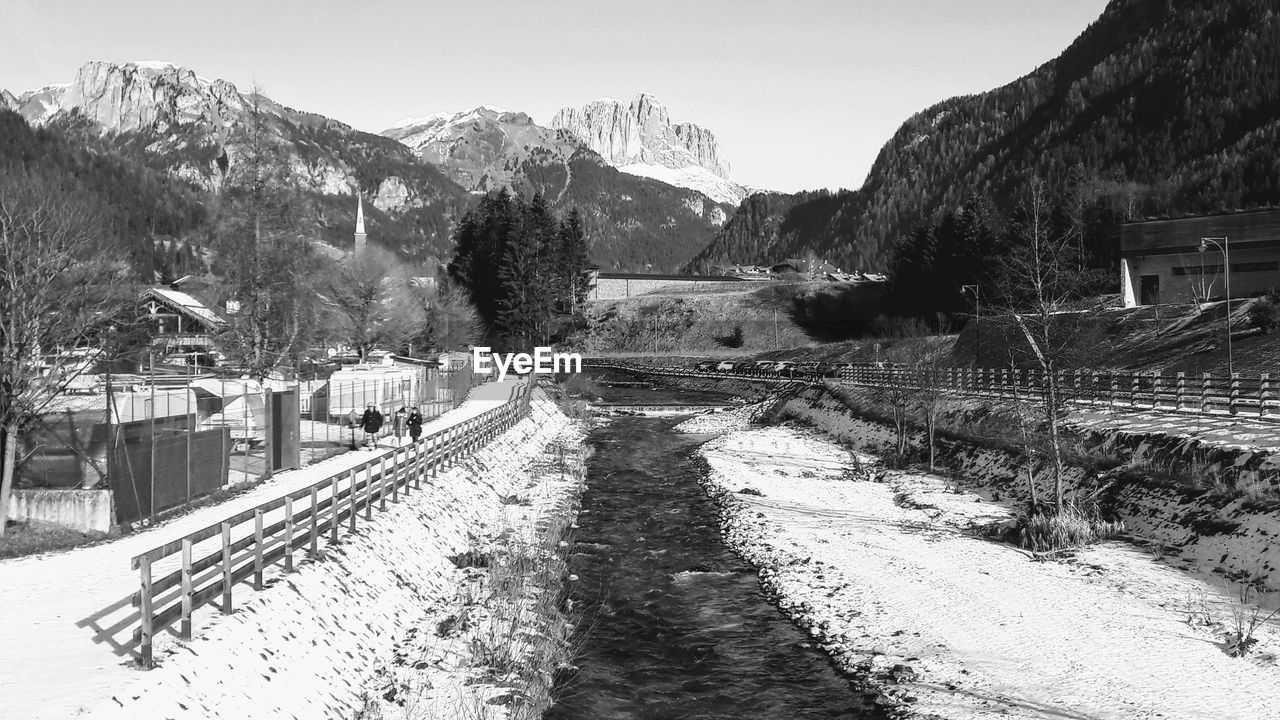 mountain, cold temperature, nature, winter, snow, transportation, plant, built structure, no people, tree, architecture, day, sky, rail transportation, direction, the way forward, building exterior, beauty in nature, road, outdoors, diminishing perspective, track