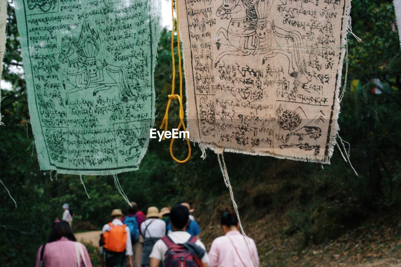 Prayer Flags With People In Background