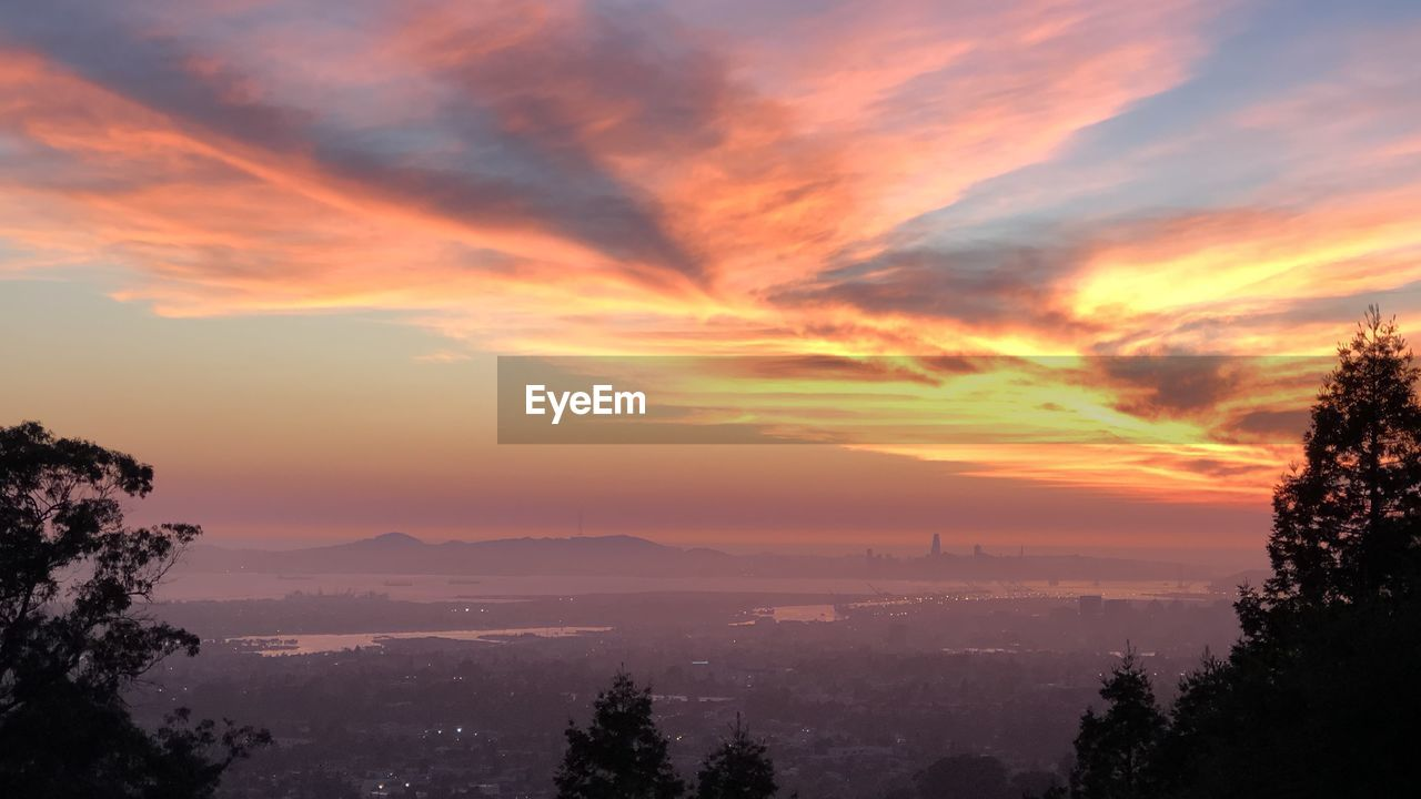 sunset, orange color, tree, beauty in nature, nature, sky, tranquility, scenics, no people, tranquil scene, cloud - sky, mountain, outdoors