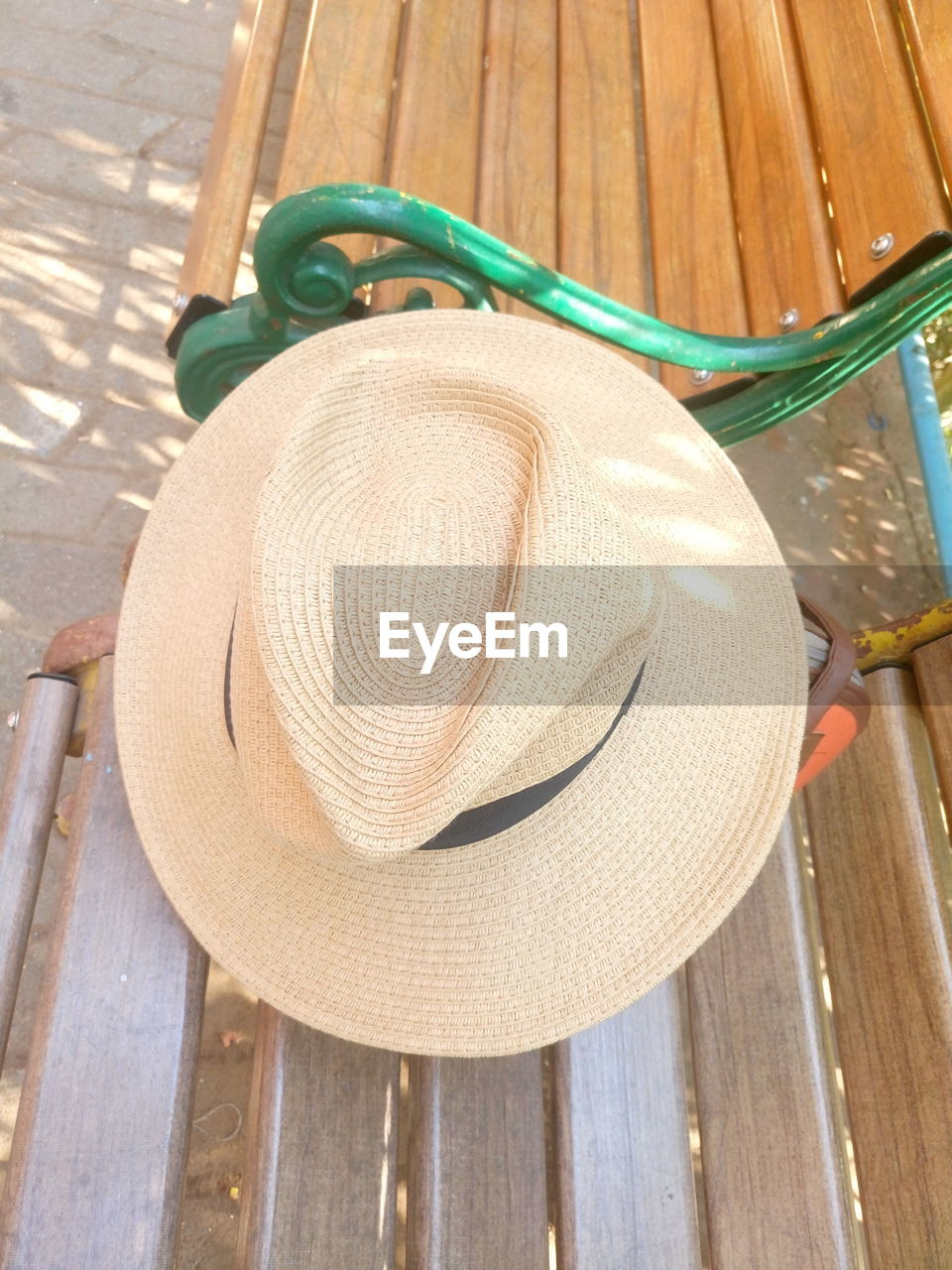 hat, high angle view, wood - material, sun hat, day, no people, table, outdoors, close-up