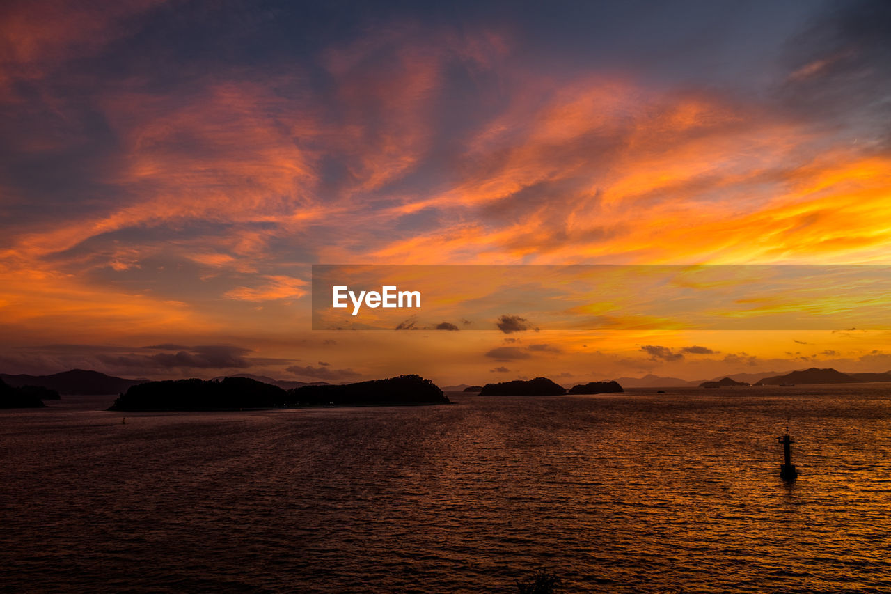 sunset, sky, water, orange color, scenics - nature, beauty in nature, cloud - sky, silhouette, tranquility, sea, waterfront, tranquil scene, nature, idyllic, non-urban scene, land, outdoors, standing, real people