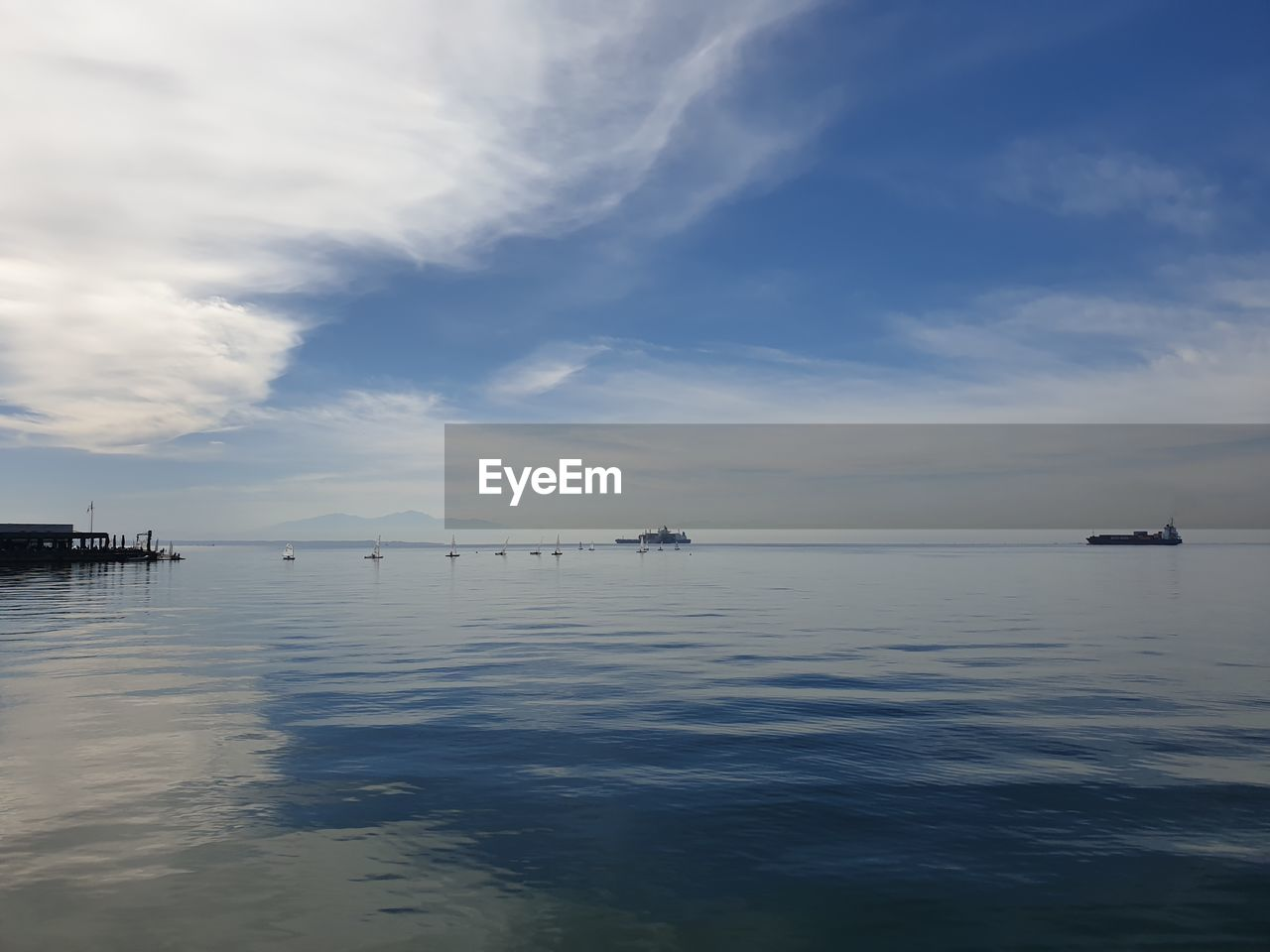 VIEW OF SAILBOATS IN SEA AGAINST SKY
