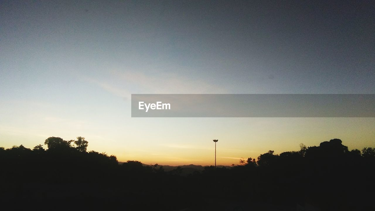 sky, sunset, silhouette, tree, plant, beauty in nature, scenics - nature, tranquility, tranquil scene, nature, copy space, no people, outdoors, growth, environment, non-urban scene, technology, orange color, idyllic, landscape