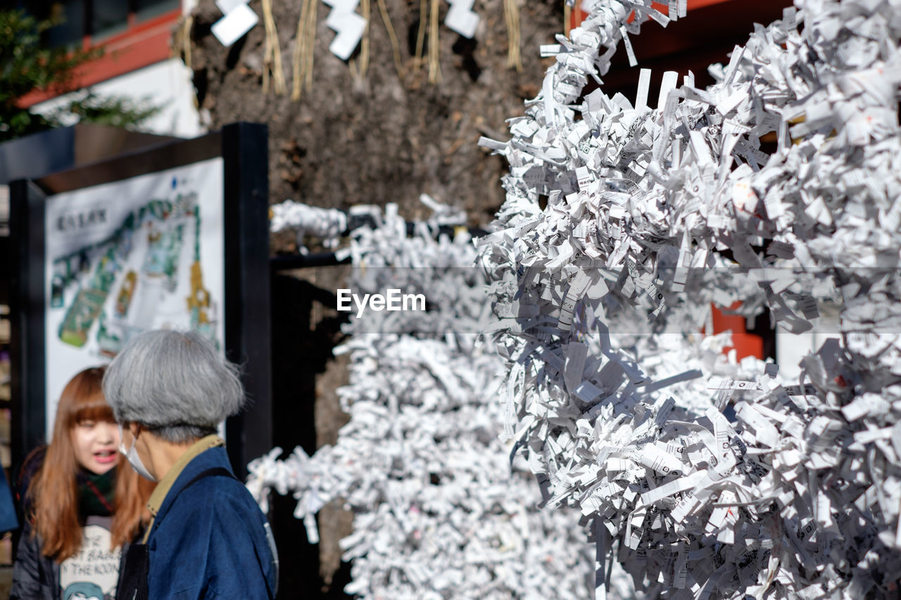 retail, store, consumerism, choice, two people, buying, abundance, for sale, winter, large group of objects, togetherness, love, market, customer, men, real people, women, day, outdoors, warm clothing, close-up, adult, people