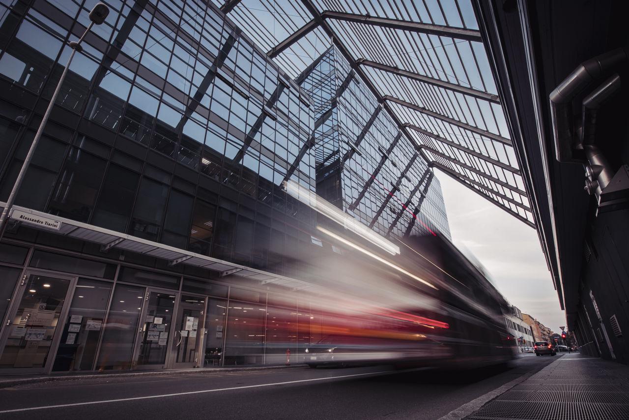 Light trails of a pubblic transportation hybrid vehicle with daylight