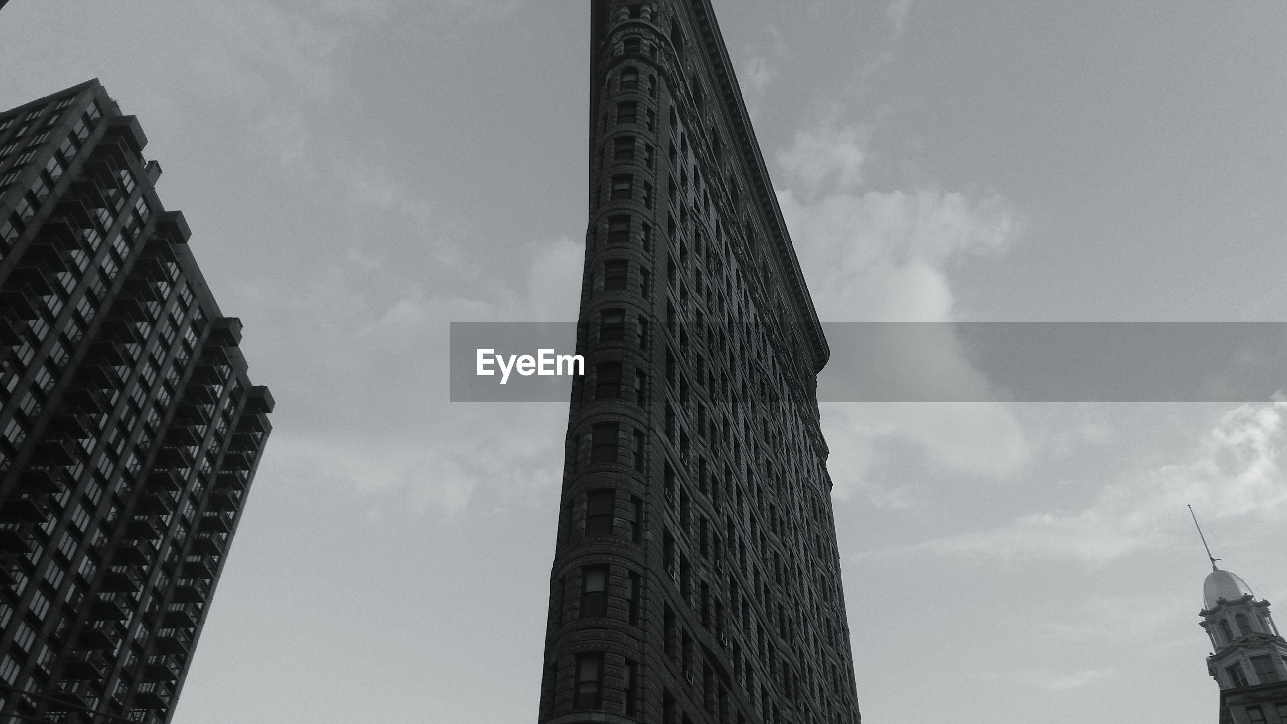 architecture, built structure, low angle view, building exterior, tall - high, sky, tower, city, skyscraper, cloud - sky, capital cities, office building, tall, modern, building, travel destinations, famous place, outdoors, day, no people