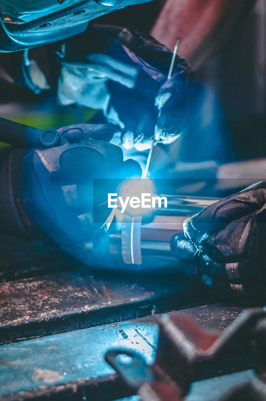 Close-up of  hands welding a tube