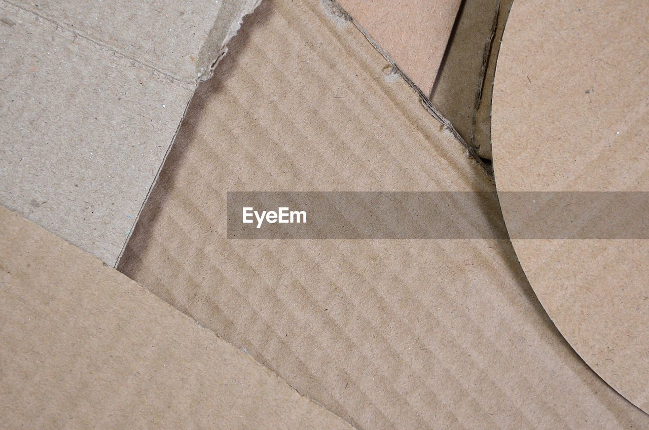 cardboard, high angle view, cardboard box, no people, full frame, paper, brown, backgrounds, box, close-up, indoors, day, container, architecture, absence, material, box - container, brown paper, pattern