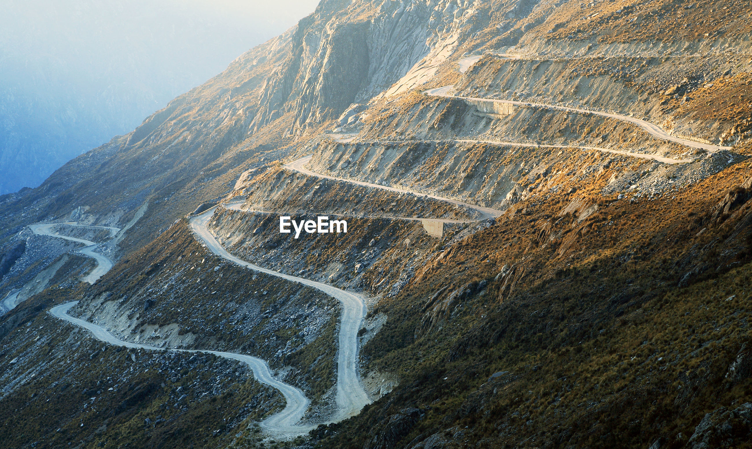 Zigzag road over rocky mountain