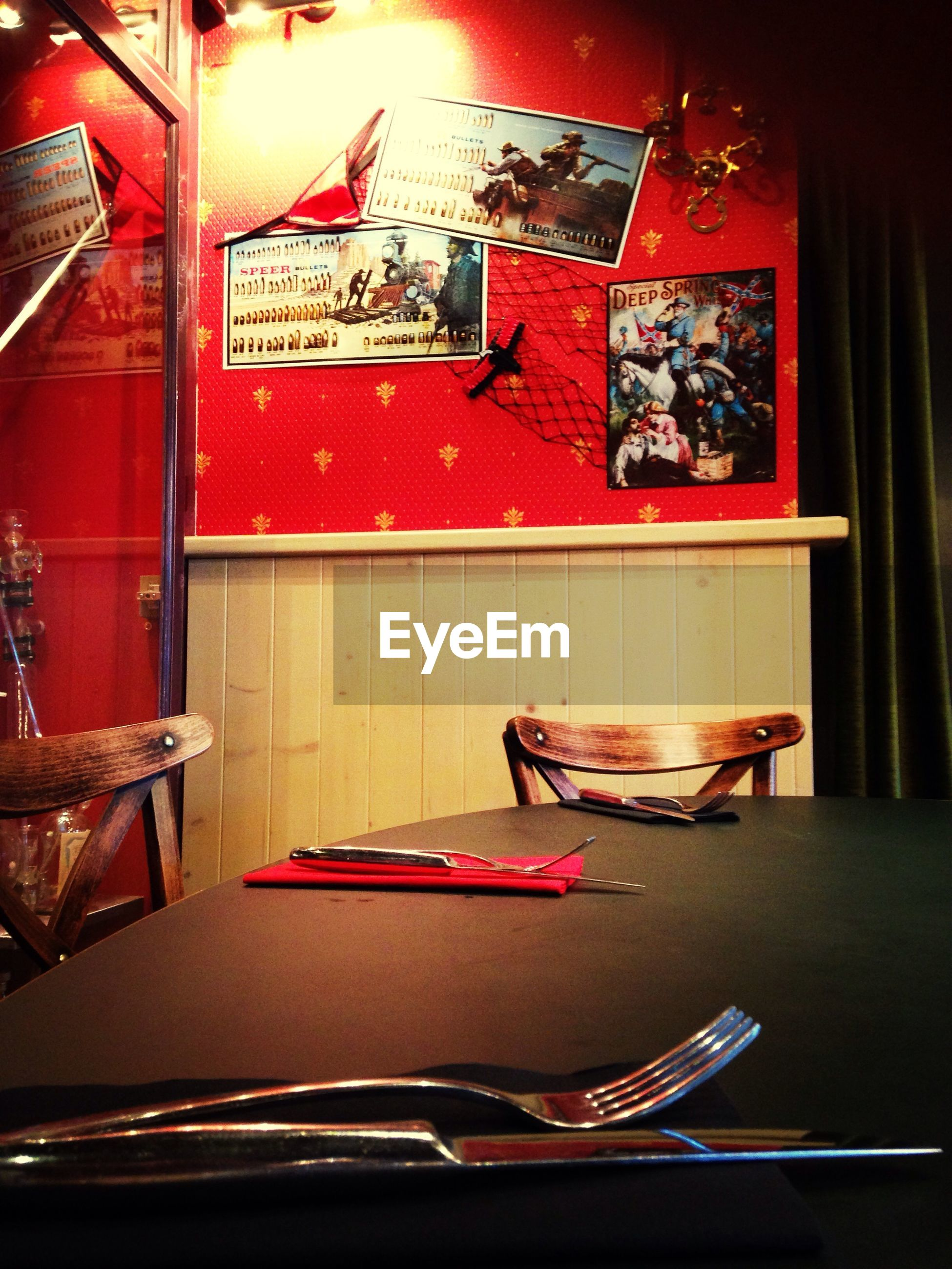 indoors, table, absence, still life, chair, empty, home interior, red, no people, restaurant, furniture, illuminated, book, text, communication, wood - material, seat, close-up, high angle view, luxury