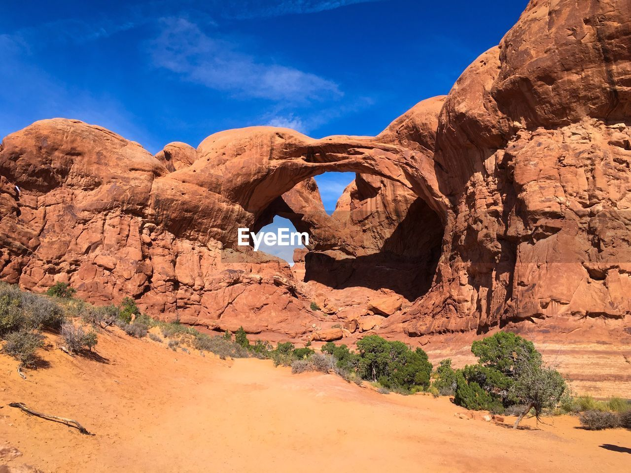 Scenic view of rock formations at arches national park against blue sky