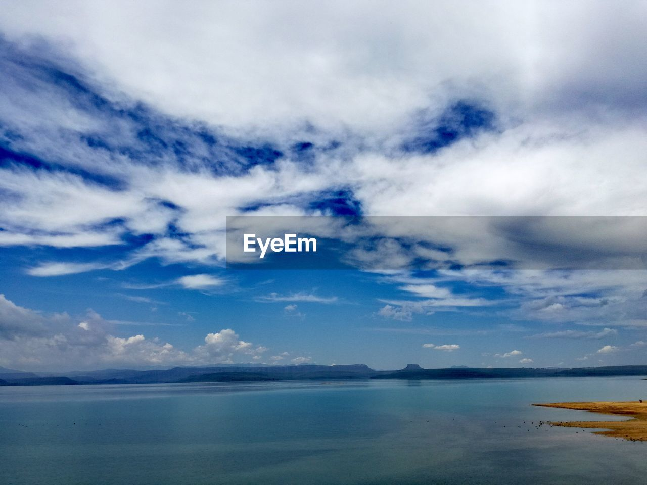 sky, cloud - sky, beauty in nature, scenics - nature, water, tranquility, tranquil scene, sea, nature, waterfront, day, no people, blue, horizon, idyllic, horizon over water, non-urban scene, outdoors, beach