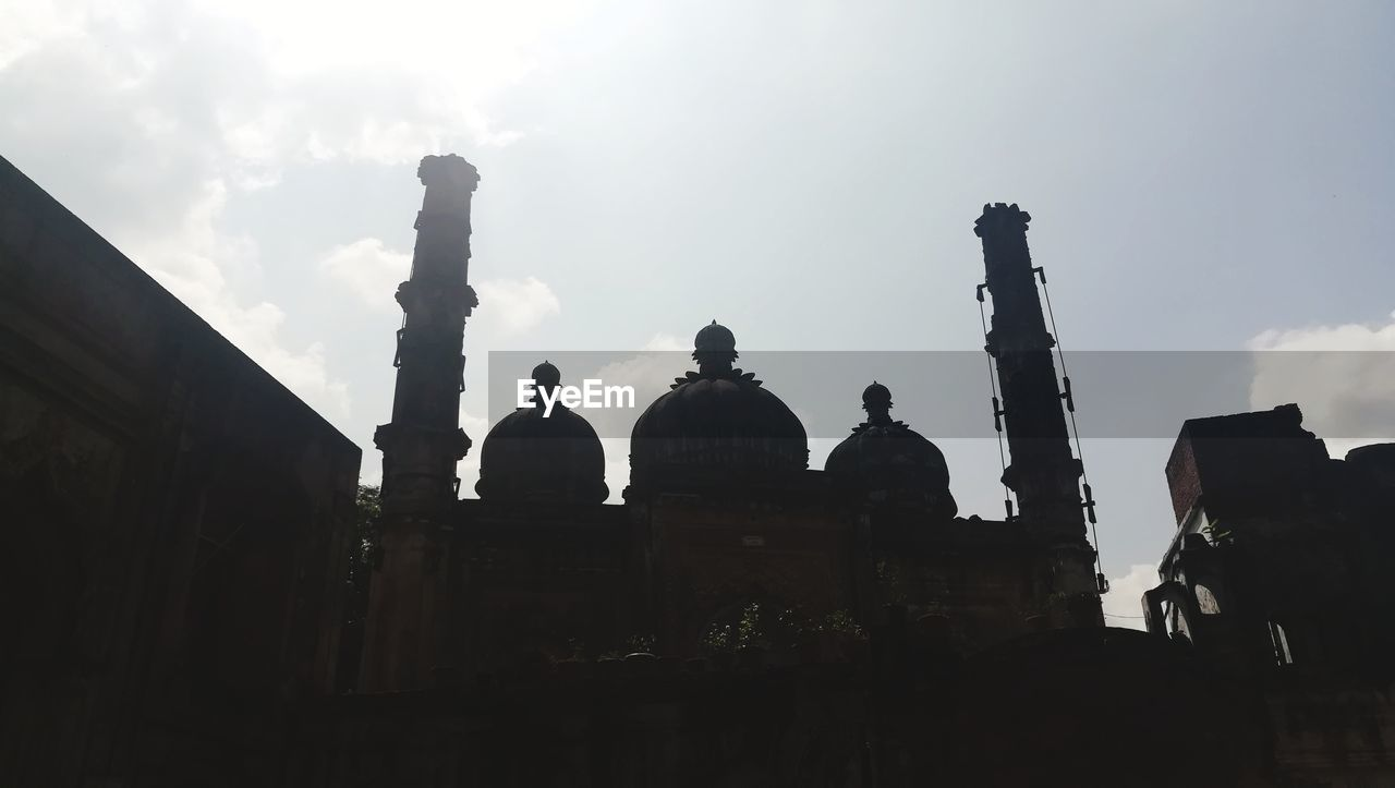 architecture, low angle view, built structure, history, silhouette, building exterior, religion, spirituality, travel destinations, outdoors, place of worship, sky, statue, sculpture, day, ancient civilization, no people