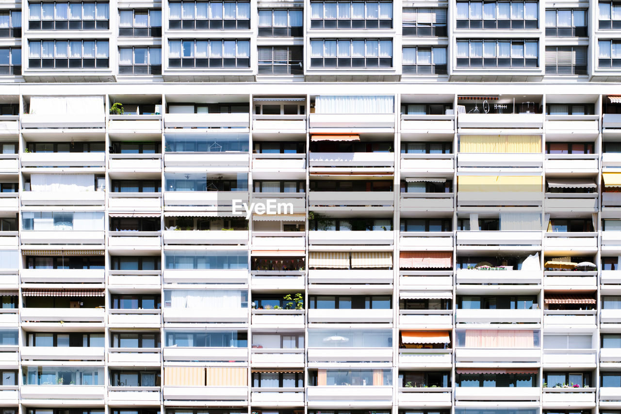 built structure, building exterior, architecture, full frame, no people, building, window, repetition, backgrounds, pattern, city, in a row, large group of objects, residential district, day, apartment, modern, outdoors, side by side
