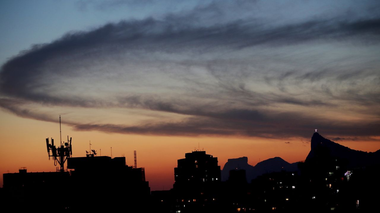 sunset, sky, architecture, building exterior, built structure, silhouette, cloud - sky, orange color, building, city, no people, nature, beauty in nature, cityscape, outdoors, residential district, scenics - nature, dramatic sky, illuminated