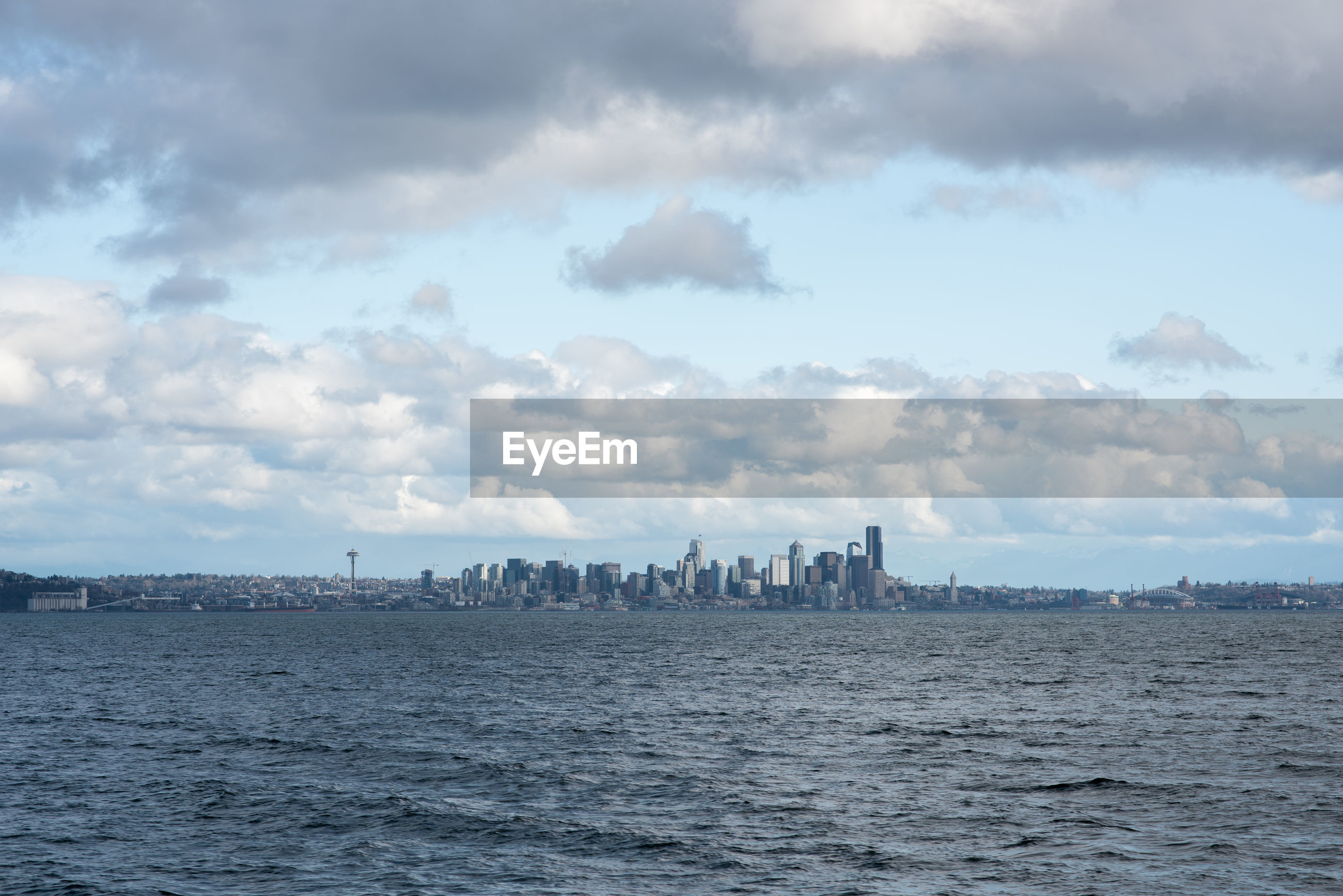 PANORAMIC SHOT OF SEA AND CITYSCAPE AGAINST SKY