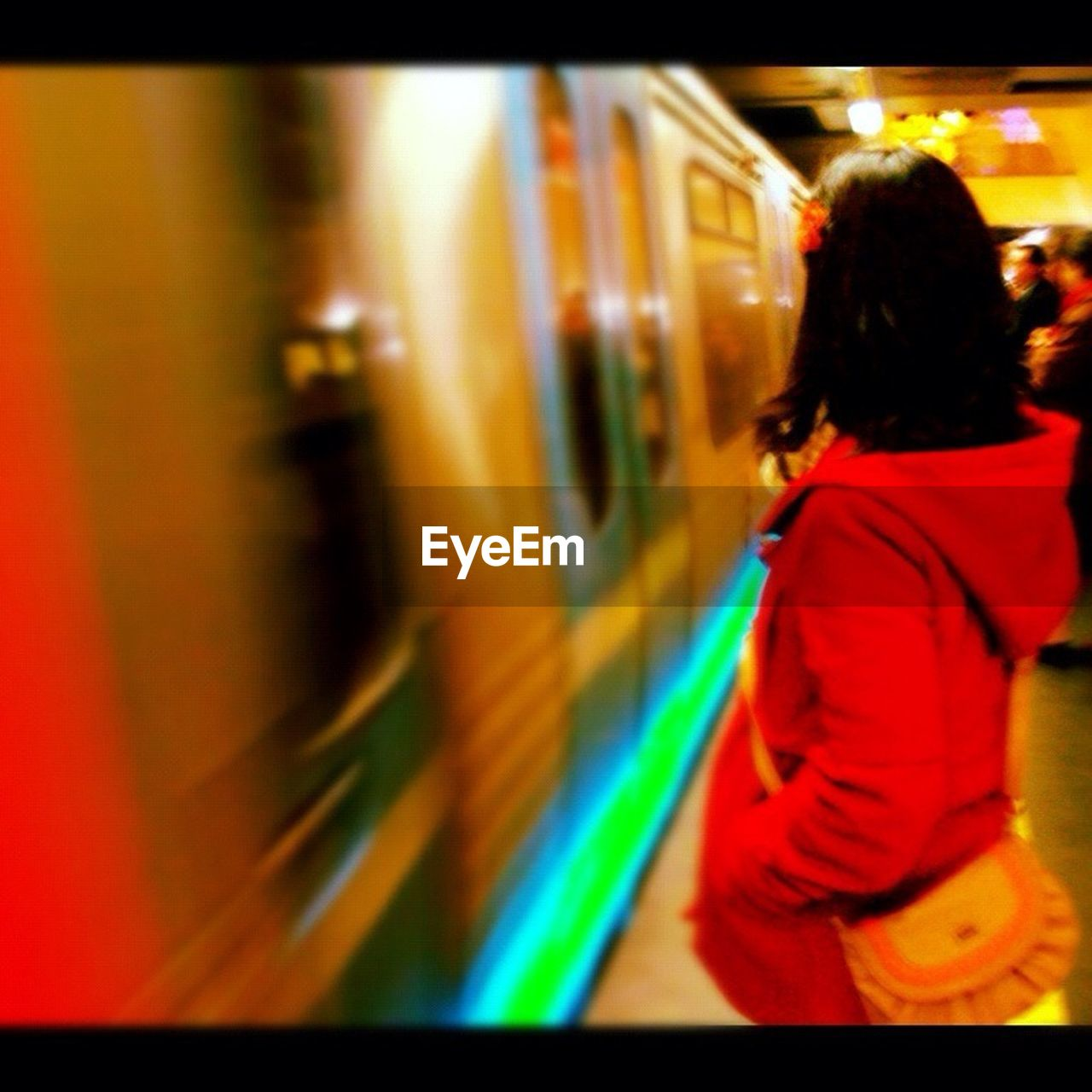 train - vehicle, transportation, public transportation, passenger train, subway train, rear view, blurred motion, rail transportation, subway station, casual clothing, one person, journey, standing, real people, illuminated, commuter train, women, night, indoors, people, adult, adults only