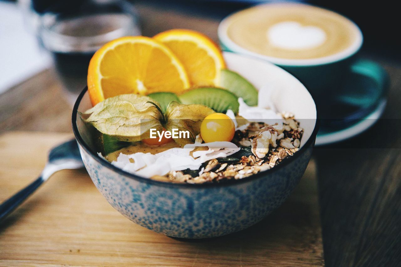 food and drink, food, table, healthy eating, freshness, fruit, wellbeing, bowl, still life, indoors, citrus fruit, ready-to-eat, no people, wood - material, close-up, lemon, high angle view, focus on foreground, slice, breakfast, temptation