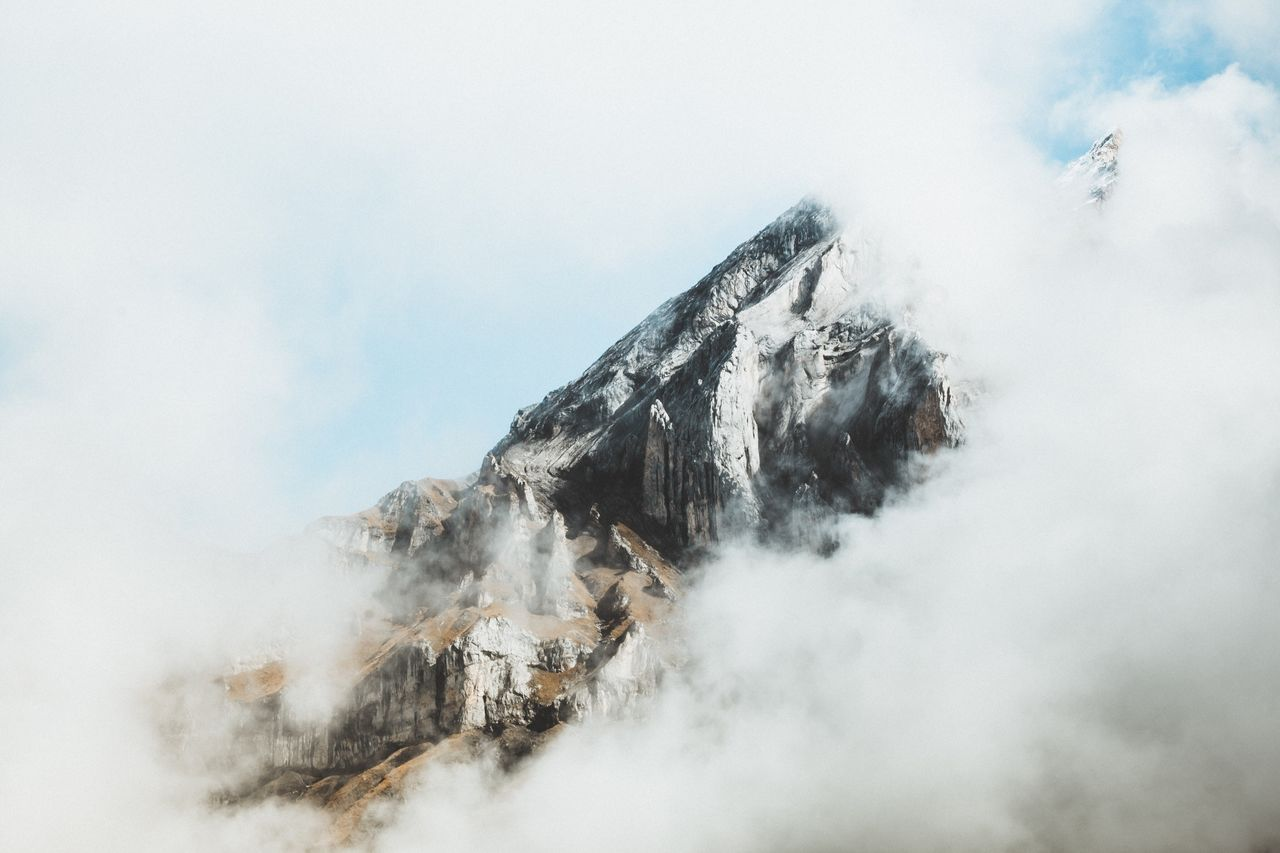 Scenic View Of Mountain Against Sky During Winter