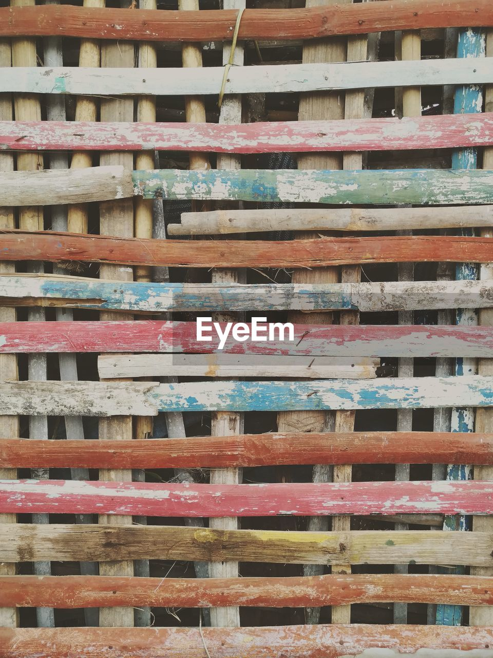 full frame, backgrounds, no people, wood - material, architecture, pattern, large group of objects, built structure, stack, day, multi colored, abundance, outdoors, building exterior, repetition, close-up, in a row, low angle view, textured